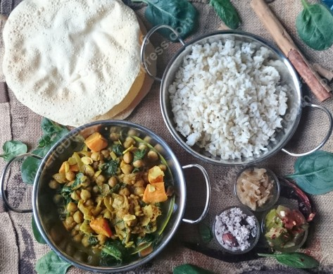 Vegan curry, rice, poppadums and relishes.