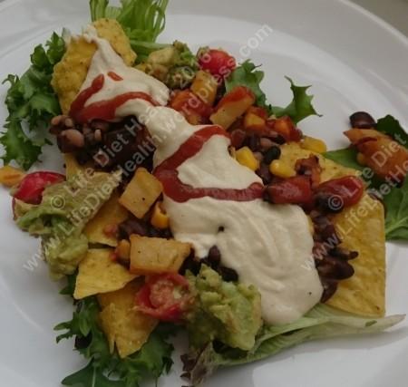 Corn tortillas, spicy black beans, guacamole, lemon potatoes, cheeze sauce and chilli drizzle