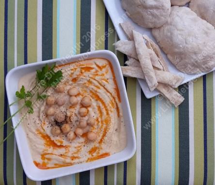 Dressed up houmous with pitta strips