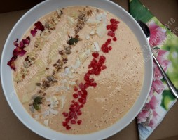 Frozen raspberries, coconut, mixed seeds, flaked almonds, chopped nuts & rose petals.