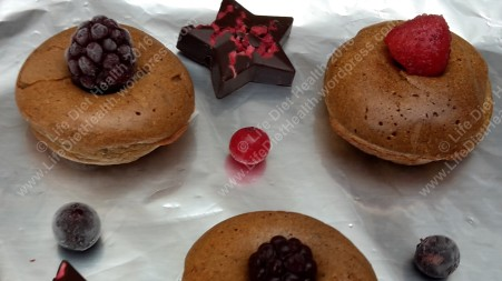 Delicious donuts with fresh fruit