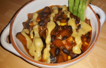 Chili with cheesey sauce and fresh avocado