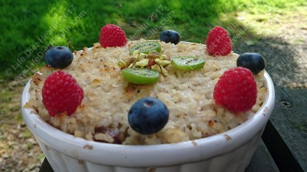 Rice pudding topped with fresh fruits & nuts