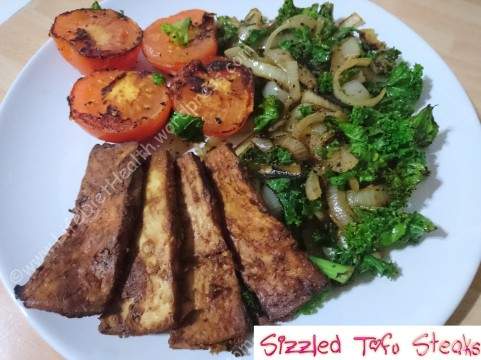 Served with griddled tomatoes and kale stir fry.